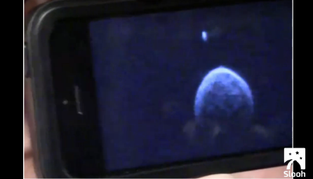 A video still of asteroid 2004 BL86, which swept safely past Earth earlier today.  Image via Slooh.com.  View the video segment.