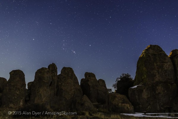 View larger.    Comet Lovejoy on January 5, 2015.  The scene shows the constellation Orion rising, with Lovejoy (C/2014 Q2) at upper right as the fuzzy green spot, in a moonlit sky over the formations of the City of Rocks State Park, New Mexico. The moon, a day past full, had risen and was behind the rocks lighting the sky and tops of the formations. Scattered moonlight illuminated the scene. Alan Dyer, who took this photo, said,