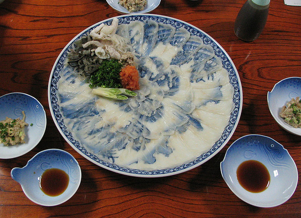 Fugu sashimi, sliced very thin. I want those puffer-shaped condiment dishes. Image: Peter Kaminski.
