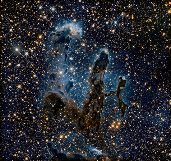 Infrared view of the Pillars of Creation.   Unlike in the visible-light view, this view shows newly born stars, forming from the gas and dust in this region of space.