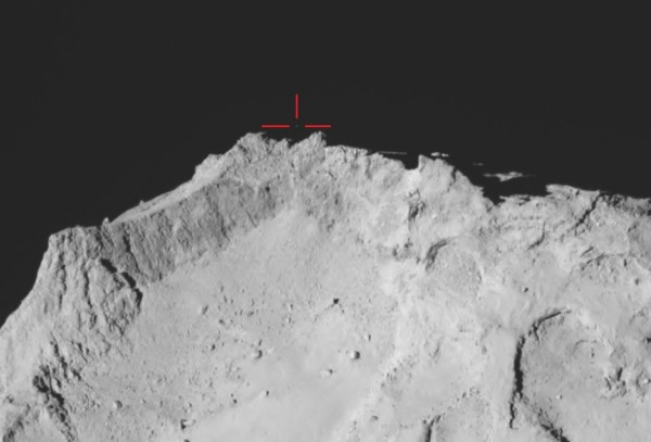 View larger. | The Philae Lander against black space just off the comet's surface during the first bounce after failing to land properly on Comet 67P/Churyumov–Gerasimenko within the red crosshairs .