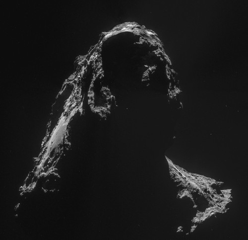 View larger. | Rosetta obtained this image of its comet on November 2, 2014.  Contrast it to the image at the top of the page, and you'll see how the