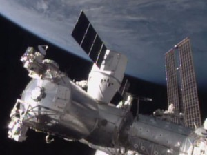 SpaceX capsule docks with International Space Station ...