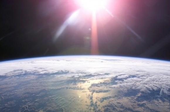 Earth and sun via ISS Expedition 13 / NASA.