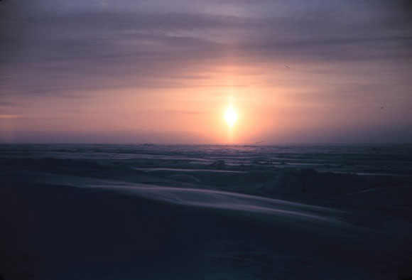 Sunpillar over the Arctic plain. Image Credit: Rear Admiral Harley D. Nygren (ret.), NOAA.