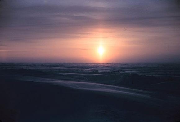 Sunpillar over the Arctic plain. Image Credit: Rear Admiral Harley D. Nygren (ret.), NOAA.