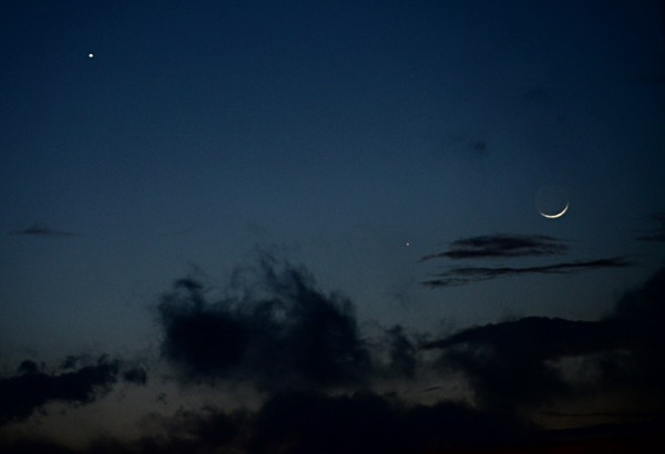 The dance of Venus, Mercury and a tiny moon, just after sunset on January 21, 2015, from Matera, Italy. Photo by Nicola D'antona of the Osservatorio Astronomico Università di Siena.