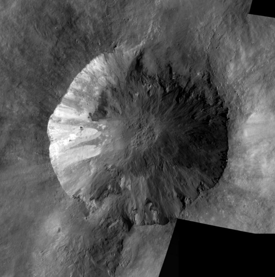 Another look at the crater Cornelia on Vesta.  Mosaic of Low-Altitude Mapping Orbit images of Cornelia crater, Vesta This mosaic is composed of five images of Vesta captured by Dawn during its Low Altitude Mapping Orbit phase. The images were taken between January 11 and March 13, 2012. At full resolution, it is about 20 meters per pixel, covering an area about 30 kilometers across.