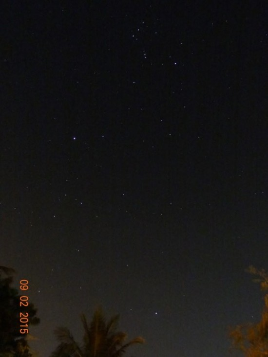 Starry sky, constellation Orion, two widely separated bright stars.