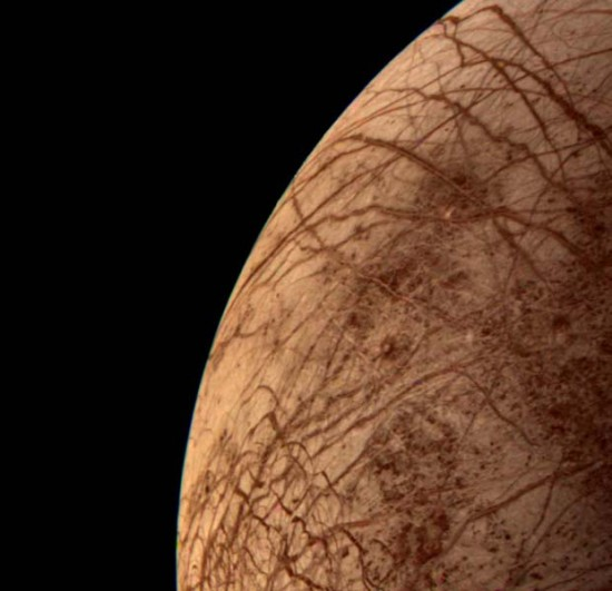 This color image of the Jovian moon Europa was acquired by Voyager 2 during its close encounter on Monday morning, July 9, 1979. Europa, the size of our moon, is thought to have a crust of ice perhaps 100 kilometers thick which overlies the silicate crust. The complex array of streaks indicate that the crust has been fractured and filled by materials from the interior.
