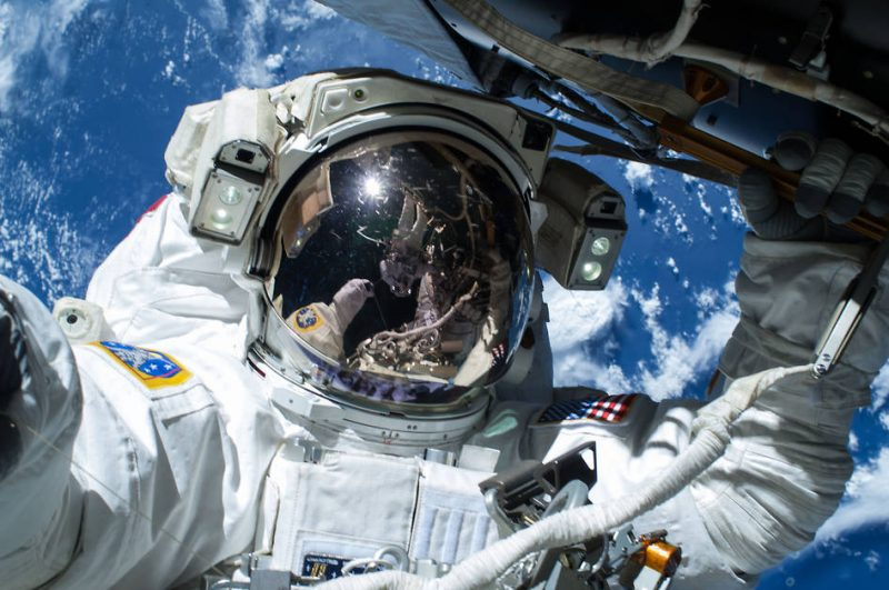 NASA astronaut Barry Wilmore works outside the International Space Station on the first of three spacewalks preparing the station for future arrivals by U.S. commercial crew spacecraft, Saturday, February 21, 2015. Fellow spacewalker Terry Virts, seen reflected in the visor, shared this photograph on social media.  View larger. \  Image credit; NASA