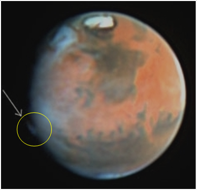 A curious plume-like feature was observed on Mars on 17 May 1997 by the Hubble Space Telescope. It is similar to the features detected by amateur astronomers in 2012, although appeared in a different location.