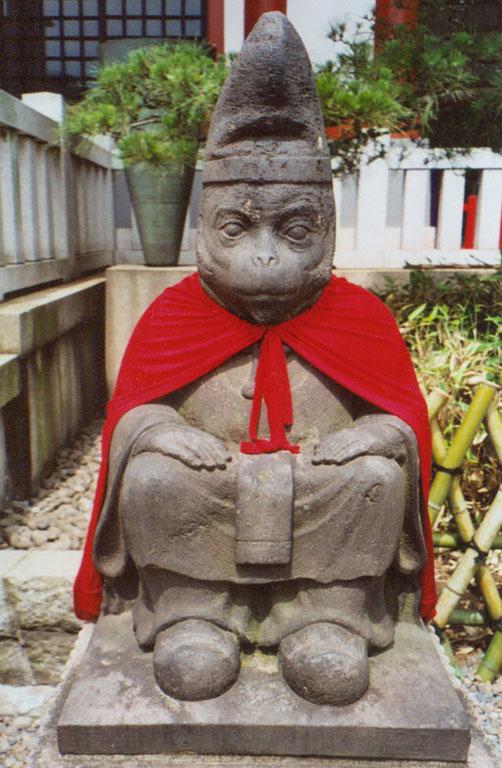 Monkey statue at a Tokyo shrine. Photo Bantosh, via Wikimedia Commons.