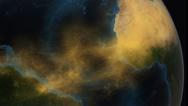 Conceptual image of dust from the Saharan Desert crossing the Atlantic Ocean to the Amazon rainforest in South America. Credit: Conceptual Image Lab, NASA/Goddard Space Flight Center