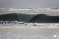 View larger. | Slushy waves on a Nantucket beach, February 20, 2015.  Photo by Jonathan Nimerfrosh.