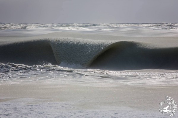 View larger. | Slushy waves on a Nantucket beach, February 20, 2015.  Photo by Jonathan Nimerfrosh.