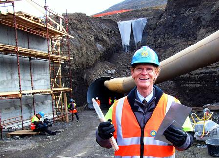 Cary Fowler in front of the Svalbard Global Seed Vault being built on Spitsbergen, showing the kind of containers used for the seeds.  Image via Wikimedia/Bair175
