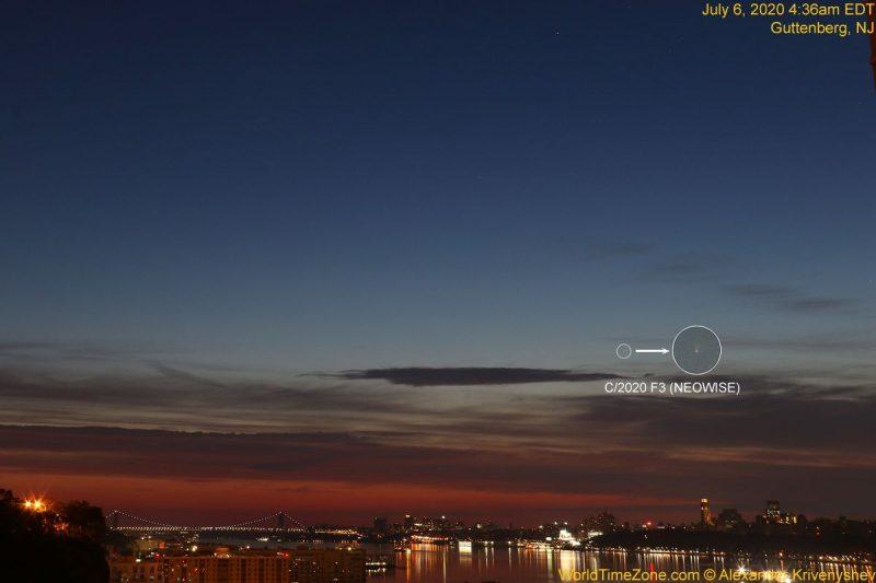 A faint comet in the twilight dawn sky over New York City's glittering skyline.