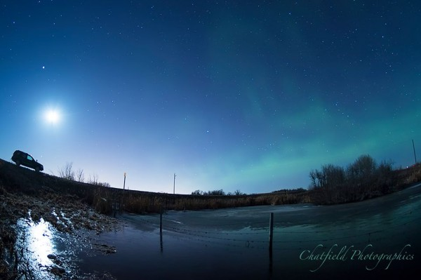 Colin Chatfield in Saskatoon, SK, Canada caught the moon and Jupiter on the morning of March 29 (above truck, on left).  On the right is a greenish glow ... an aurora!