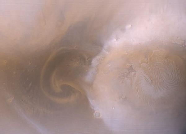 Mars is dusty.  We knew that.  It's a desert world, and - when it's spring in either hemisphere - vast dust storms spring up on the Martian surface.  But we did not know that about the presence of dust so high in the Martian atmosphere.
