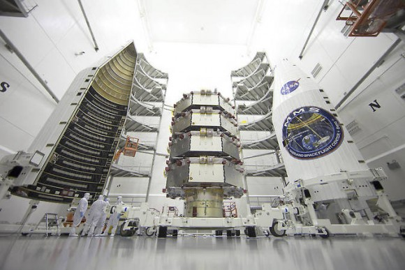 NASA's Magnetospheric Multiscale (MMS) observatories are processed for launch in a clean room at the Astrotech Space Operations facility in Titusville, Florida. MMS consists of four identical spacecraft that will provide the first three-dimensional views of a process known as magnetic reconnection. Image credit: NASA/Ben Smegelsky