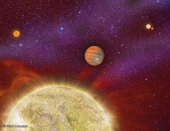 This artist's conception shows the 30 Ari system, which includes four stars and a planet. The planet, a gas giant, orbits its primary star (yellow) in about a year's time. Image copyright: Karen Teramura, UH IfA