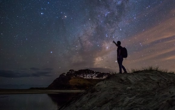 View larger. | Saturn (left) and Antares are the two brightest objects in this self-portrait from Amit Kamble, taken on March 1, 2015.  You can also see the starry band of the Milky Way in this part of the sky.  Amit was in Pakiri, an area being developed as a regional park near Auckland, New Zealand.  Thank you, Amit!
