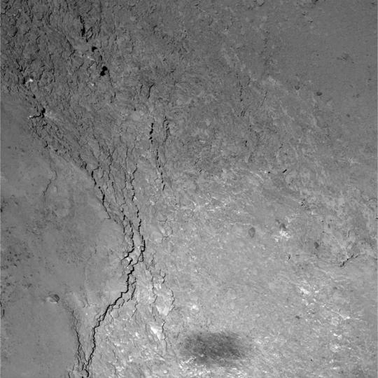 The Rosetta spacecraft's shadow on the comet it has been orbiting since last August.