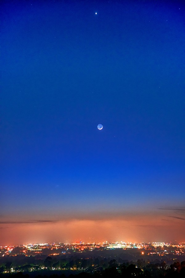Jim Hatcher caught Mars to the lower right of the moon - and Venus above - on March 21 from San Diego.