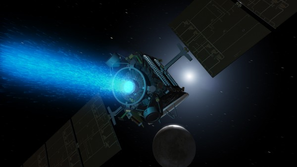This artist's concept shows Dawn thrusting with its center ion engine high above the night side of Ceres, which displays only a narrow crescent below the spacecraft. The gentle but efficient thrust allows Dawn to change the shape of its orbit. It will complete this first phase of orbital maneuvering on April 23.. Image via NASA/JPL