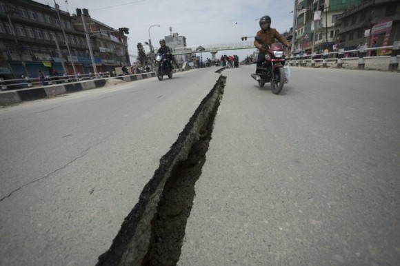 A crack in a road near Kathmandu caused by the earthquake. Photo credit: EPA/Hemanta Shrestha