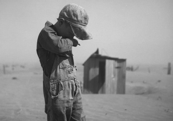 A young boy covers his mouth during a dust storm on farm. Cimarron County, Oklahoma. April 1936. Image credit: Arthur Rothstein; The Library of Congress, Prints & Photographs Division