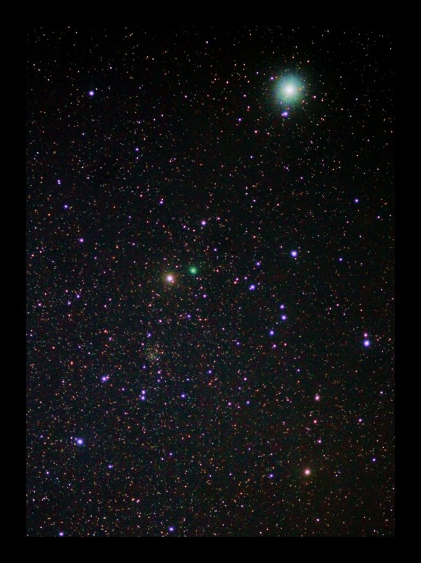 View larger.   Comet Lovejoy on May 22, 2015.  The comet is the brilliant green dot near the center of the photo.  At the upper right of the photo is the star Polaris, aka the North Star.  Photo by Stuart Atkinson.  Used with permission.