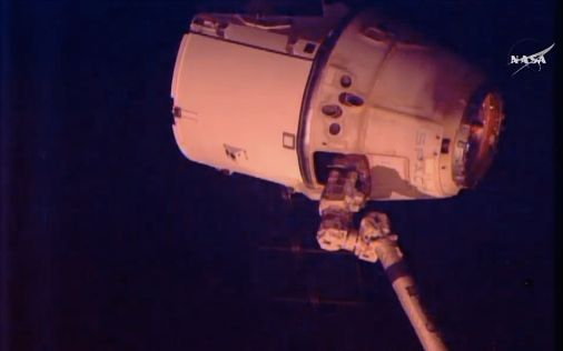 Dragon cargo craft moments before its release from iSS.  Image is a video still from NASA TV.