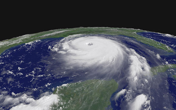Oblique orbital view of large round white hurricane with distinct spirals and eye.