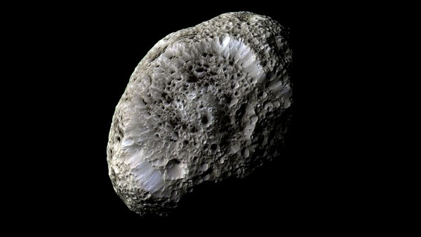 This false-color view of Hyperion was obtained during Cassini's closest flyby of Saturn's odd, tumbling moon on Sept. 26, 2005. Image via NASA/JPL-Caltech/SSI