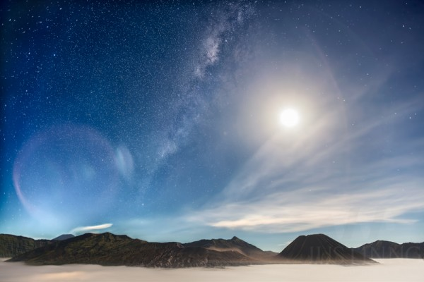 View larger. | Milky Way against a bright Moon at Mount Bromo during the peak of Eta Aquarid meteor shower, by Justin Ng of Singapore.