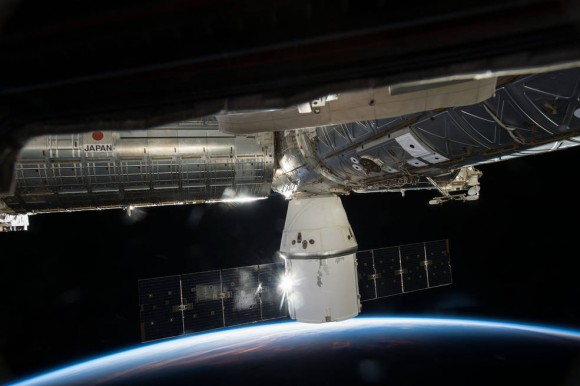 SpaceX's Dragon cargo capsule is seen here docked to the Earth-facing port of the Harmony module of the International Space Station. SpaceX's sixth commercial resupply flight arrived at the station on April 17. Image credit: NASA