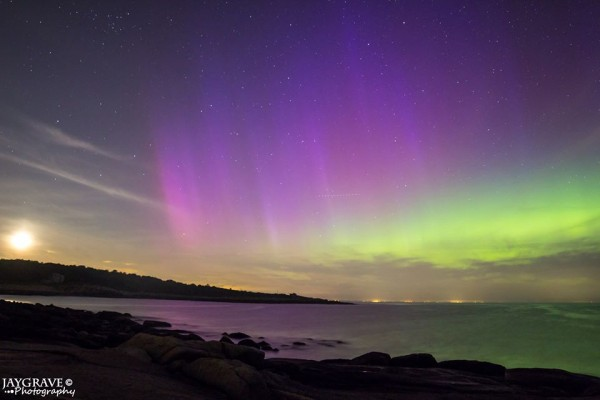 Setting moon and northern lights over Rockport, Massachusetts, captured by John Gravell.  He wrote: