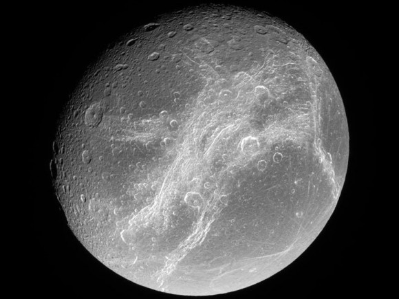 Bright cliffs across Saturn's moon Dione.  Image via Cassini Imaging Team, SSI, JPL, ESA, NASA