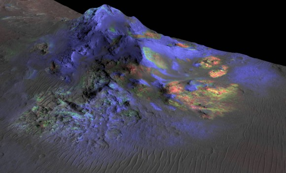 Researchers have found deposits of impact glass (in green) preserved in Martian craters, including Alga Crater, shown here. Image credit: NASA/JPL-Caltech/JHUAPL/Univ. of Arizona