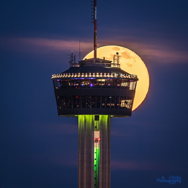 June 2, 2015 full moon behind the Tower of the Americas in San Antonio, Texas, from Chicky Leclair.