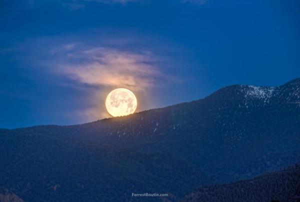 Forrest Boutin Photography in Colorado Springs, Colorado caught the moon set Tuesday morning.  Thank you, Forrest!