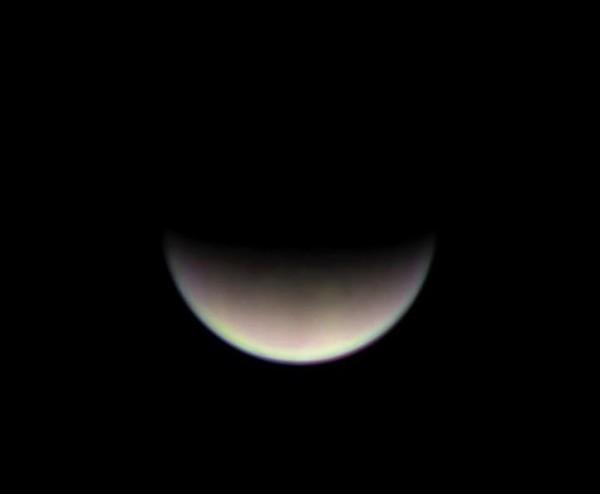 View larger.   Crescent Venus captured from Puerto Rico by Efraín Morales of the Sociedad de Astronomía del Caribe.