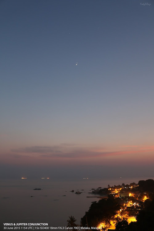 Our friend on G+ Mohamad Fadzli caught Venus and Jupiter tonight - June 30, 2015 - as the sun set over Melaka, Malaysia.  Thank you, Mohamad!