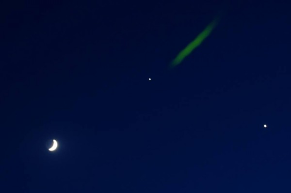 Venus, Jupiter, the moon and a firefly on June 20, 2015 by Sandy Carter in Kansas