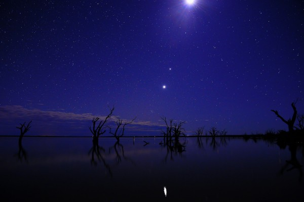 Even after the moon sweeps past them, the show in the western sky after sunset is not over.  Jupiter and Venus will be drawing closer through late June and early July.  Grant Schwartzkopff in Australia captured this photo on June 22, 2015.