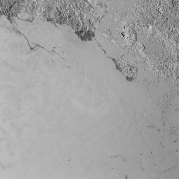 This image and the following two show the smoother nitrogen Ice plains of Sputnik Planum within Tombaugh Regio. Areas shown are approximately 230 miles (370 km) across.  All images on this page via New Horizons spacecraft using the LORRI (LOng Range Reconnaissance Imager) camera.