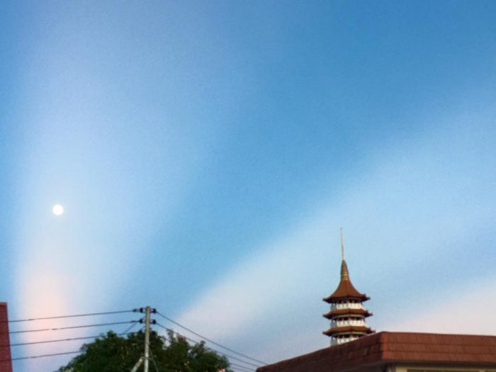 Anticrepuscular rays and a rising moon caught by Jenney Disimon in Sabah, North Borneo on June 4, 2015.