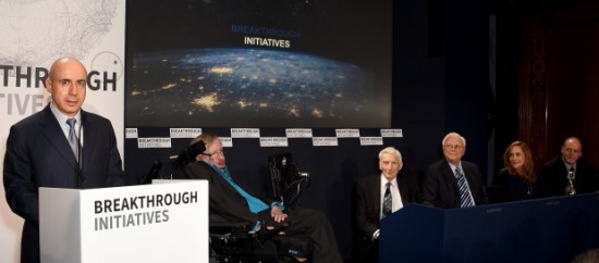 """Russian billionaire Yuri Milner announces the Breakthrough Listen and Breakthrough Message projects in London on Monday. The panel at right includes physicist Stephen Hawking, astronomer Martin Rees, SETI pioneer Frank Drake, """"Cosmos"""" producer Ann Druyan and astronomer Geoffrey Marcy. Photo via Breakthrough Initiatives, via Geekwire."""